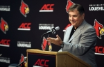 Louisville athletic director Tom Jurich talks with media during an ACC news conference Tuesday, July 1, 2014, in Louisville, Ky. After bouncing around in three other leagues over 19 years, Tuesday marked Louisville's official entry into the ACC. (AP Photo/The Courier-Journal, Alton Strupp)