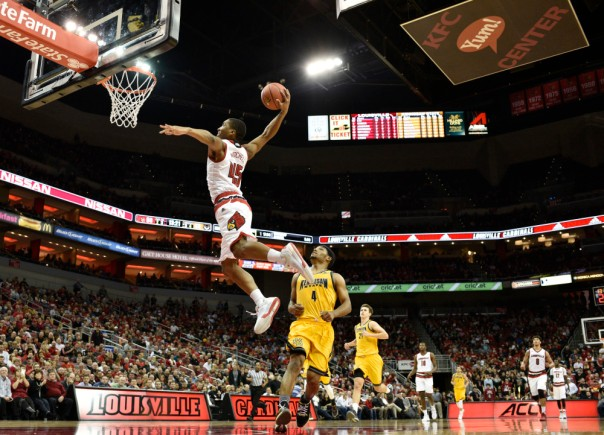 Dec 16, 2015; Louisville, KY, USA; Louisville Cardinals guard Donovan Mitchell (45) dunks against Kennesaw State Owls guard Yonel Brown (4) during the second half at KFC Yum! Center. Louisville defeated Kennesaw State 94-57. Mandatory Credit: Jamie Rhodes-USA TODAY Sports
