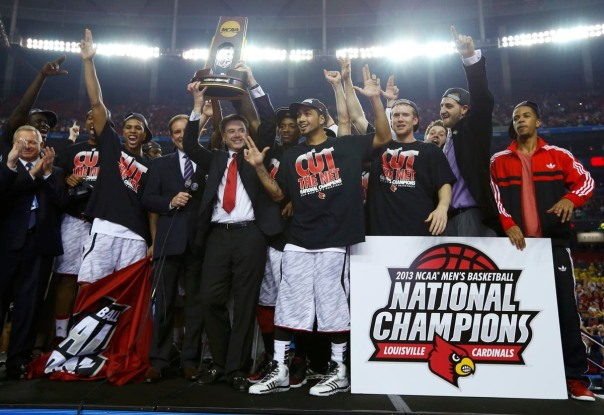 Louisville Cardinals head coach Pitino holds up the trophy as he and his team celebrate after defeating the Michigan Wolverines in their NCAA men's Final Four championship basketball game in Atlanta