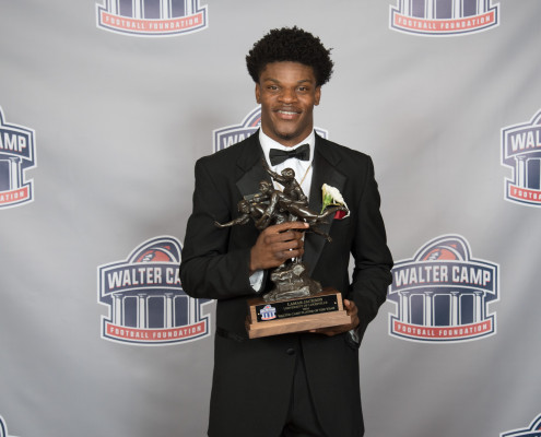 Lamar-with-WCPOY-Trophy-495x400-1.jpg